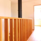 注文住宅 かっこいい工務店 鹿児島県 日置市 西郷建築 大工と創る家 施工例1 2階 子ども部屋から寝室 渡り廊下 煙突